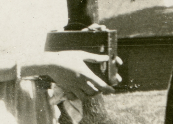 Detail of what is likely a Kodak No.3, Model B camera in use, circa 1920s