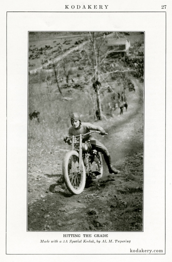 Image taken from the January 1923 issue of Kodakery of a motorcycle rider coming down a hill