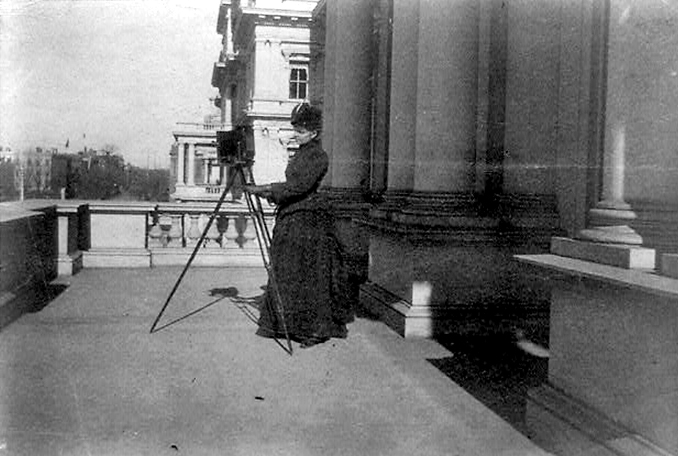Pioneer female photographer Frances Johnston pictured with a large-format camera in Washington, D.C.