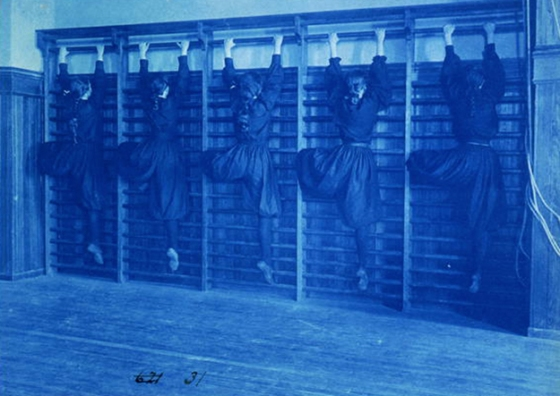 Circa 1899 cyanotype photo of high school girls climbing apparatus, Frances Benjamin Johnston