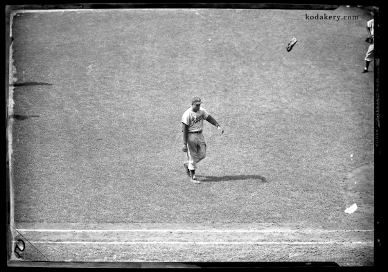 Vintage 5x7 negative of Brooklyn Dodger pitcher Don Newcombe throwing his glove in the air after being removed from a game